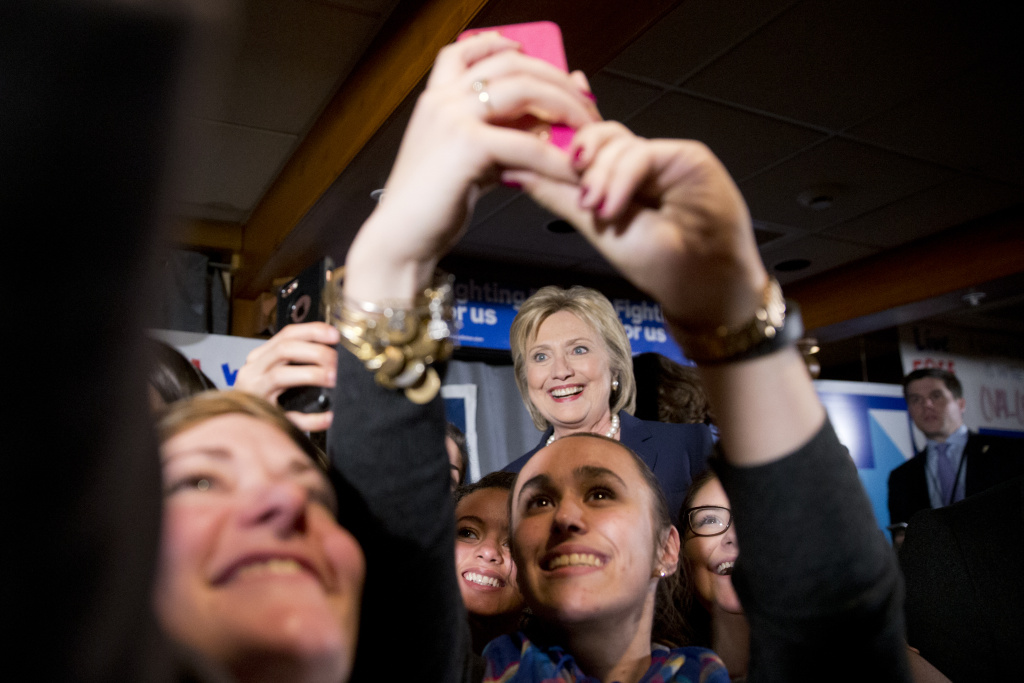 Democratic presidential candidate Hillary Clinton meets with supporters after taking part in the Democratic presidential primary debate with Sen. Bernie Sanders, I-Vt. Thursday, Feb. 4, 2016, in Durham, N.H. (AP Photo/Matt Rourke)