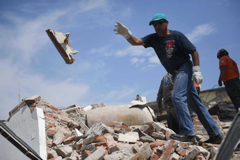 Rescuers clear the ruble in search of survivors in Juchitan de Zaragoza, a city hit hard by a powerful earthquake that struck Mexico's Pacific coast on Sunday, September 7, 2017.