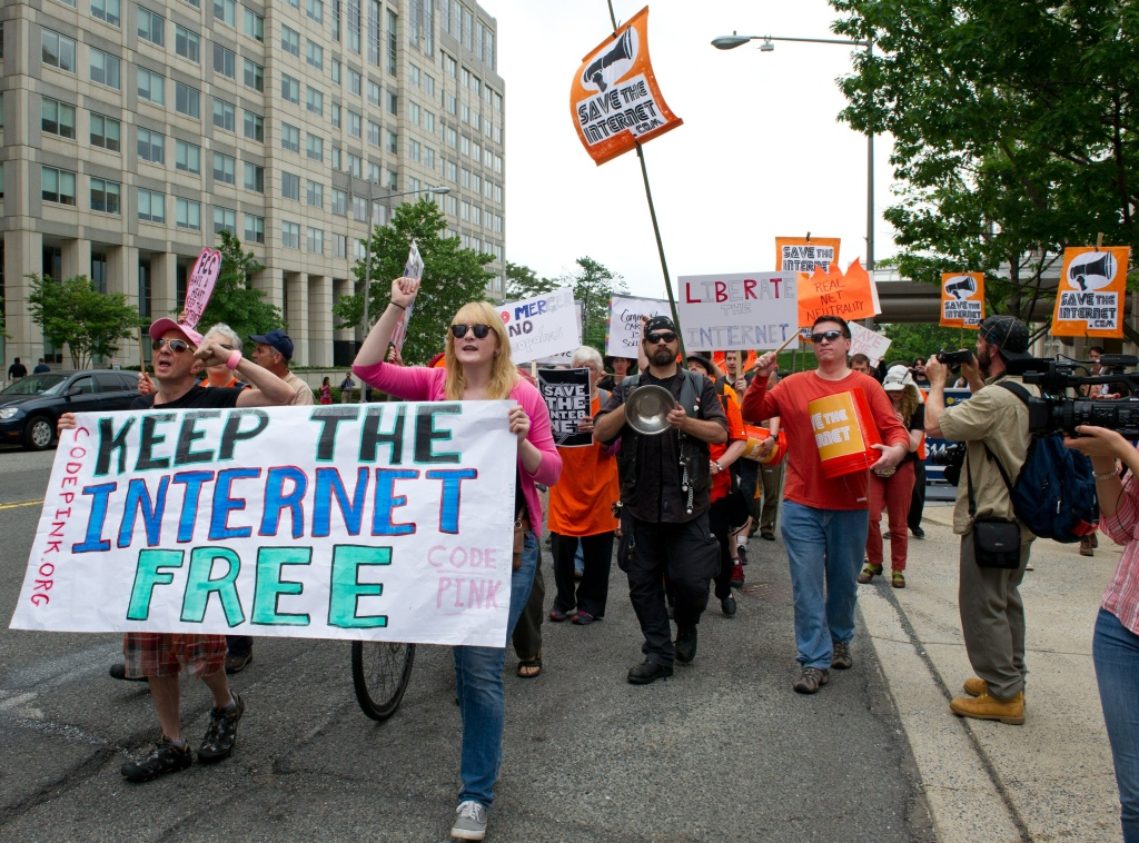 Protesters hold a rally to support 'net neutrality' and urge the Federal Communications Commission (FCC) to reject a proposal that would allow Internet service providers such as AT&T and Verizon 'to boost their revenue by creating speedy online lanes for deep-pocketed websites and applications and slowing down everyone else,' on May 15, 2014 at the FCC in Washington, DC.