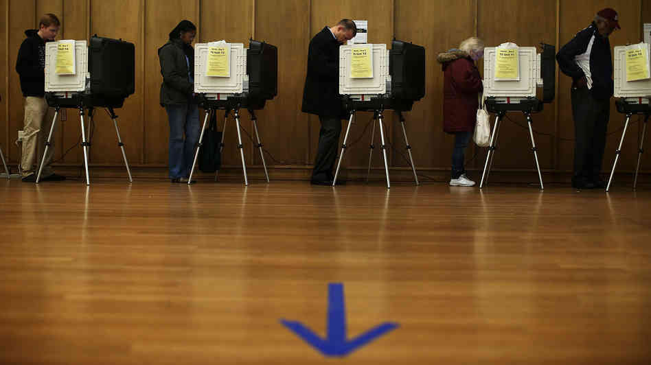 Voters participate in early voting Friday in Silver Spring, Md.