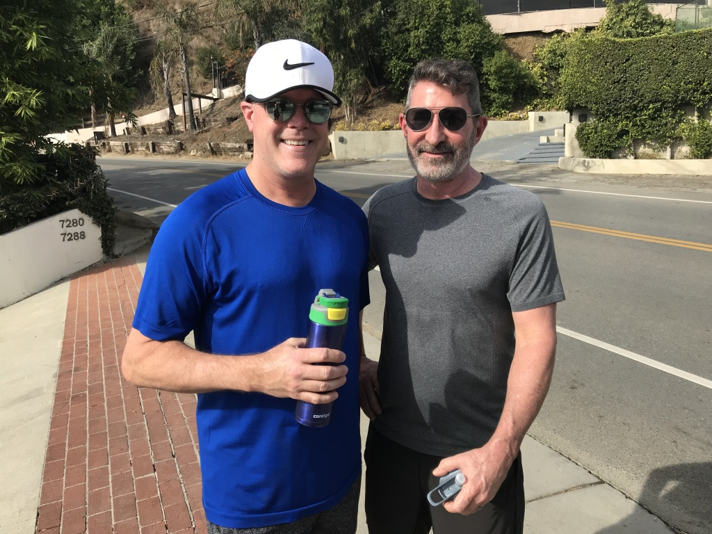 Jeff Jones (left) and Steve Johnson of Sherman Oaks on Thanksgiving day. Downtown Los Angeles hit 92 degrees.