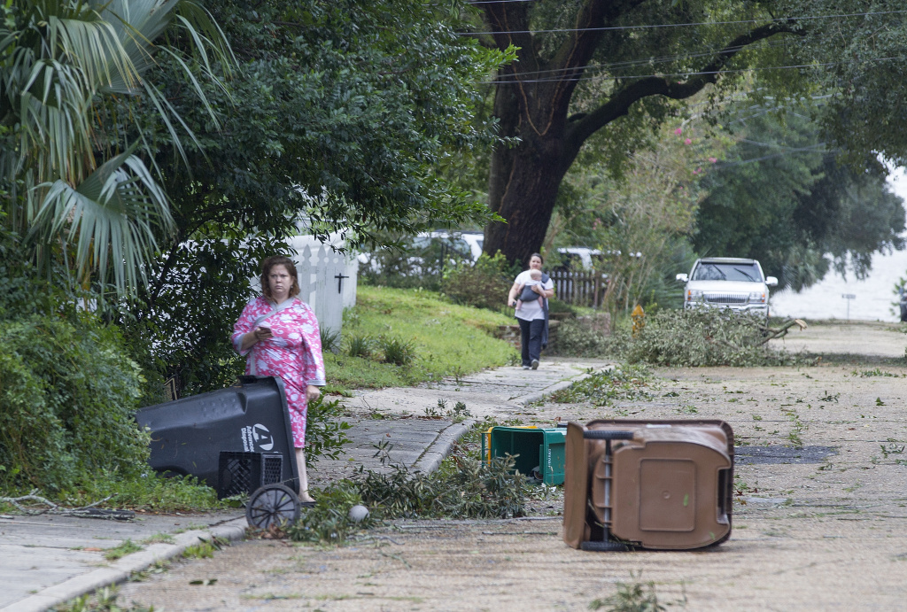 Residents of Biloxi, Mississippi venture out just after dawn on Sunday, October 8, 2017 to survey the damage after Hurricane Nate made landfall in the region.