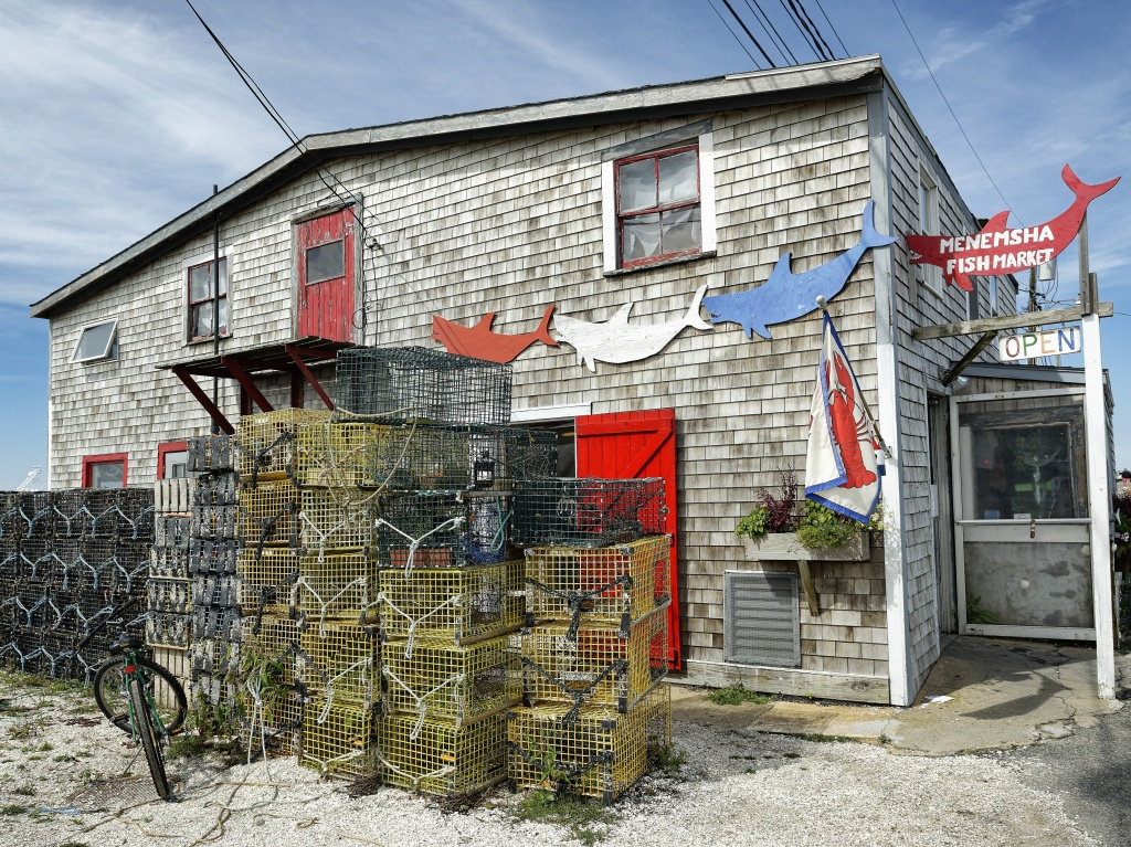 The steel used to build lobster traps like these, stacked up outside a fish market on Martha's Vineyard, is getting pricier, thanks to new tariffs.