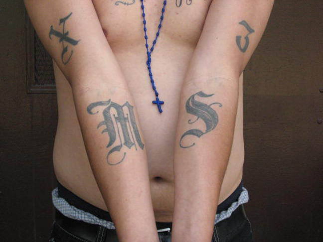 A handout photo provided by U.S. Immigration and Customs Enforcement, taken June 23, 2008, shows an example of a tattoo used by the gang Mara Salvatrucha, or MS-13. It's one of the transnational gangs that got its start in Los Angeles, but now plays a role in the instability that Central American migrants say they are fleeing as they come in large numbers to the United States. U.S. deportation policies targeting criminals and gang members have played a major role.