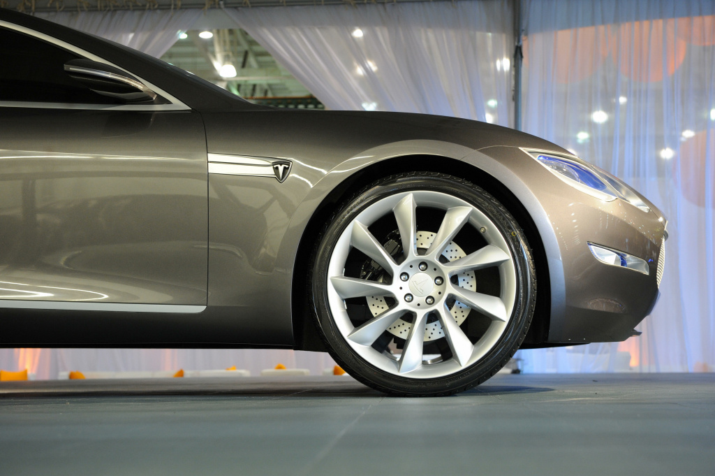 The Tesla Model S all-electric sedan (L), at the car's unveiling in Hawthorne, California on March 26, 2009.