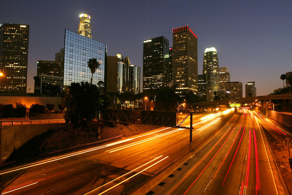 Evening traffic passes downtown high-rises along the 110 freeway on June 13, 2004.