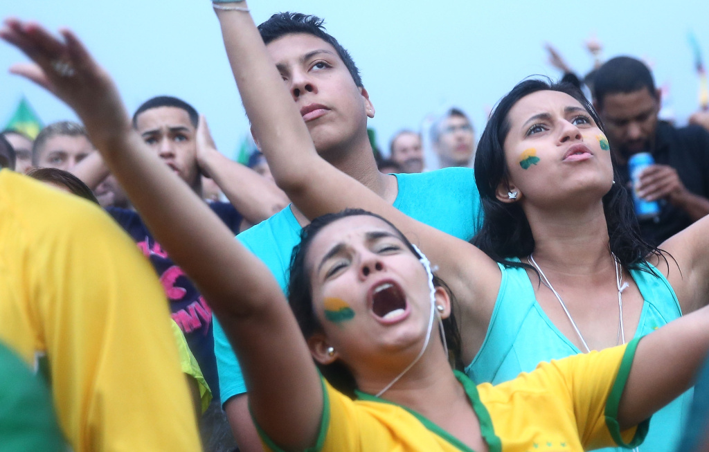 Brazil fans watch the first half on Copacabana Beach during the 2014 FIFA World Cup semi-final match between Brazil and Germany on July 8, 2014 in Rio de Janeiro, Brazil.