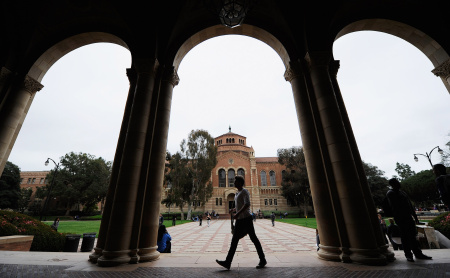 A student walks near Royce Hall on the campus of UCLA on April 23, 2012.
