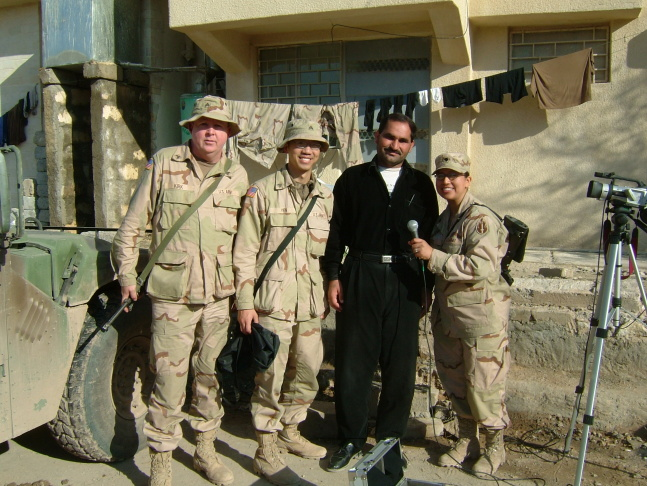 As an Army specialist during the invasion in Iraq, Oscar Barretto (third from the left in the third row) trained other soldiers how to protect themselves from chemical warfare.