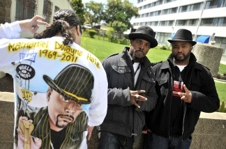Mourners come together to pay their respects to rapper Nathaniel Dwayne Hale, AKA Nate Dogg, on March 25, 2011 in Long Beach, Calif.