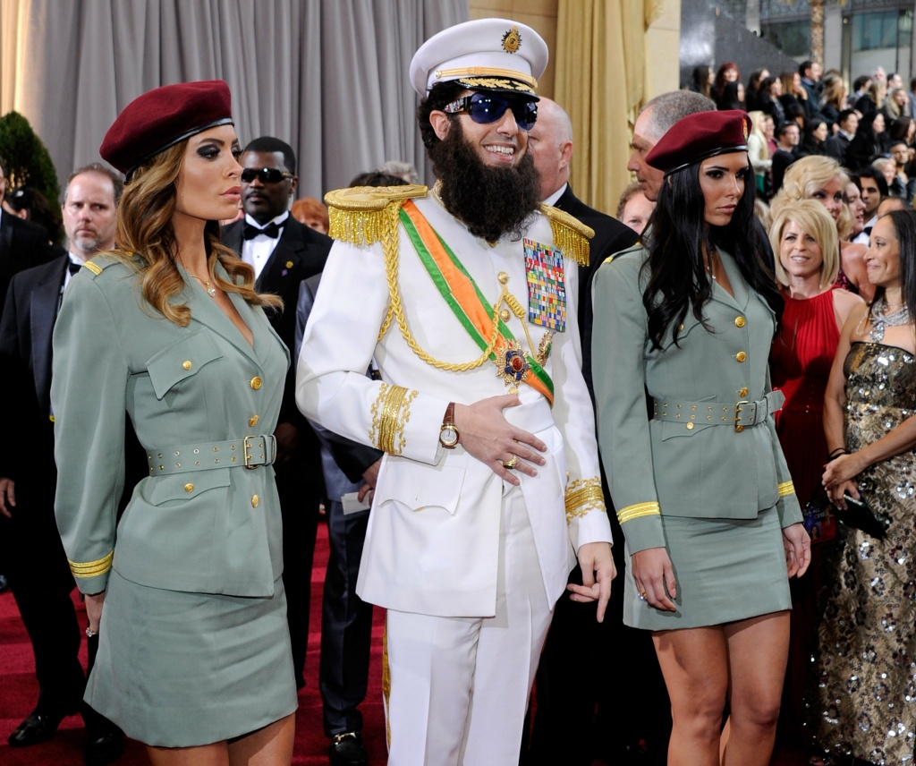 Actor Sacha Baron Cohen (C), dressed as the character General Aladeen from his movie, 'The Dictator,' arrives at the 84th Annual Academy Awards at the Hollywood & Highland Center February 26, 2012 in Hollywood, California.
