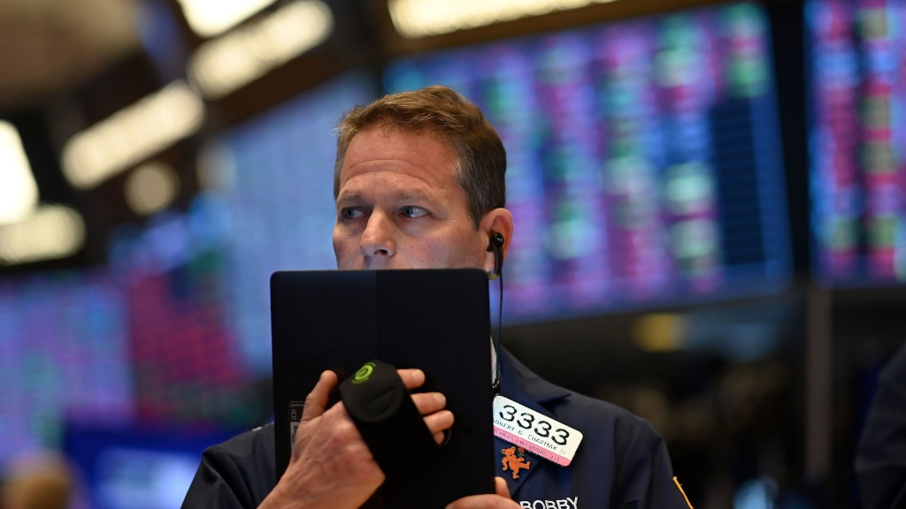 Traders work during the opening bell at the New York Stock Exchange on Thursday. Wall Street stocks opened sharply lower, amid fears the coronavirus will grow into a significant international health crisis.