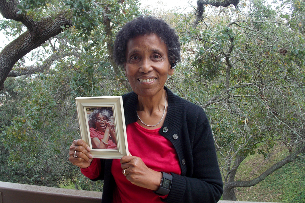 Andrea Gourdine holds a photo of her mother, Gladys Brown, who died in 2012 after being diagnosed with Alzheimer's. Brown donated her brain to UC Davis for research.