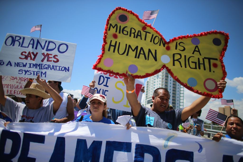 People participate in a protest march that organizers said was an attempt to get the U.S. Congress to say yes to immigration reform on April 6, 2013 in Miami, Florida. The marchers were calling for a new immigration system with a real and inclusive path to citizenship for 11 million aspiring Americans, and to keep families together.