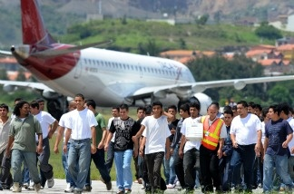 Honduran migrants deported from the United States walk on the tarmac of Toncontin Airport in Aug. 2011. Some people ordered deported, including a limited number of people who have already left, could be eligible for relief under the Senate immigration reform plan.
