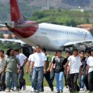 Honduran migrants deported from the United States walk on the tarmac after being repatriated in August, 2011. Newly released numbers from Homeland Security show that Obama administration deported 438,421 immigrants in fiscal year 2013, which ended Sept. 30.