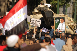 Supporters of Egyptian President Hosni Mubarak (picture) rally to show their allegiance for the embattled leader in Cairo on February 2, 2011.