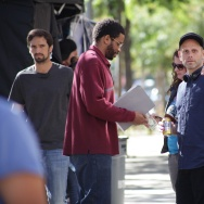 "Actor and producer Nnamdi Asomugha and director Matt Ruskin on the set of ""Crown Heights."""