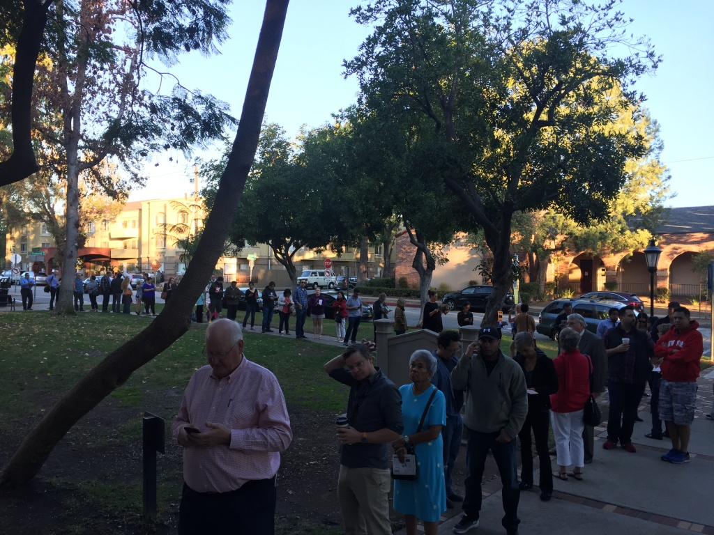 About four dozen people stood in line at the South Pasadena Library with 10 minutes to go before polls opened on Tuesday, Nov. 8, 2016.
