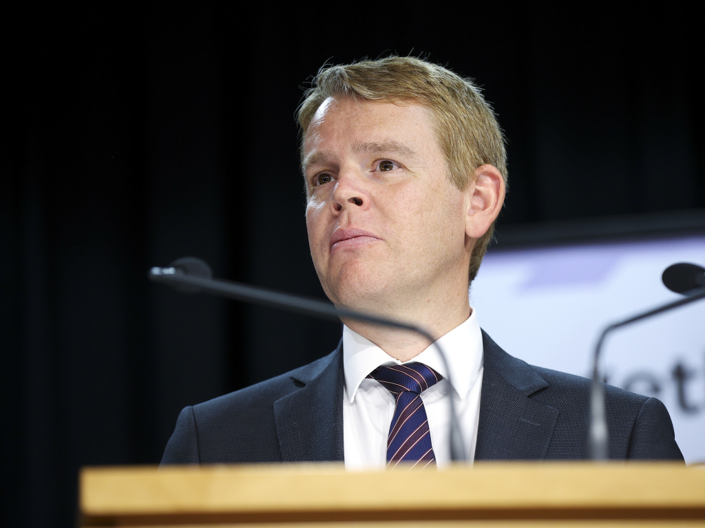 New Zealand Minister for COVID-19 Response Chris Hipkins looks on during a news conference at Parliament last month where he and Prime Minister Jacinda Ardern announced plans for a quarantine-free