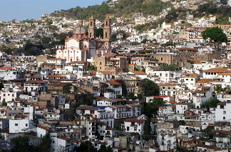 Even major tourist destinations, such as the picturesque town of Taxco in western Mexico, aren't immune to the violent onslaught. A 40-minute gun battle during the middle of the day in June left 15 people dead.