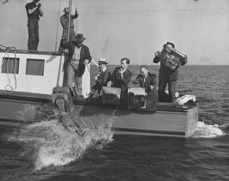 Slot machines confiscated on the SS Rex gambling ship, are being tossed overboard into the sea.