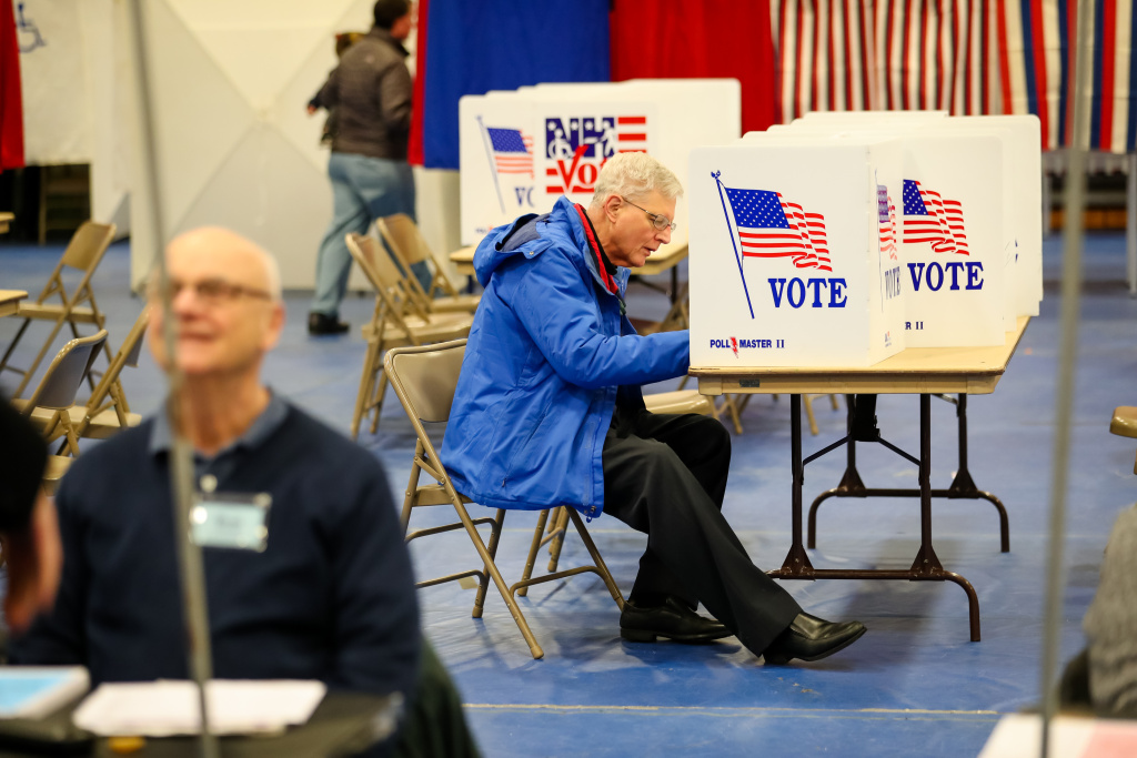 A voter casts a ballot during primary voting in New Hampshire.