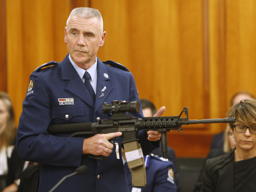 Police Sr. Sgt. Paddy Hannan shows New Zealand lawmakers an AR-15 style rifle on April 2. The country's parliament voted overwhelmingly Wednesday to ban most semi-automatic weapons after a gunman slaughtered 50 people at a mosque in March.