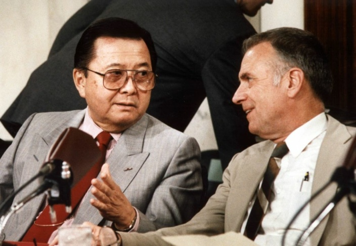Senator Daniel Inouye (L), chairman of the Senate committee holding hearings on the Iran-Contra affair, talks with House committee chairman Lee Hamilton July 13, 1987 in Washington, DC, as Lt. Col. Oliver North appeared before the joint panels for a fifth day.