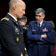 Lt. Gen. Richard Harding, Air Force judge advocate general, center, speaks with Army Lt. Gen. Dana Chipman, left, and Robert Taylor, acting general counsel of the Defense Department, prior to testifying before the Senate subcommittee on sexual assault on