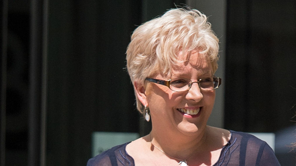 Former BBC China editor, Carrie Gracie, beams outside the BBC headquarters. Gracie recently came to an agreement regarding her equal-pay dispute with the media company.