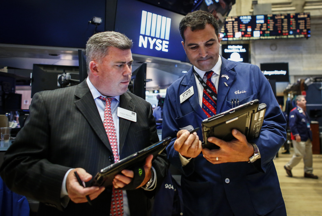 Taders works on the floor of the New York Stock Exchange (NYSE) during the evening of July 27, 2016 in New York City.