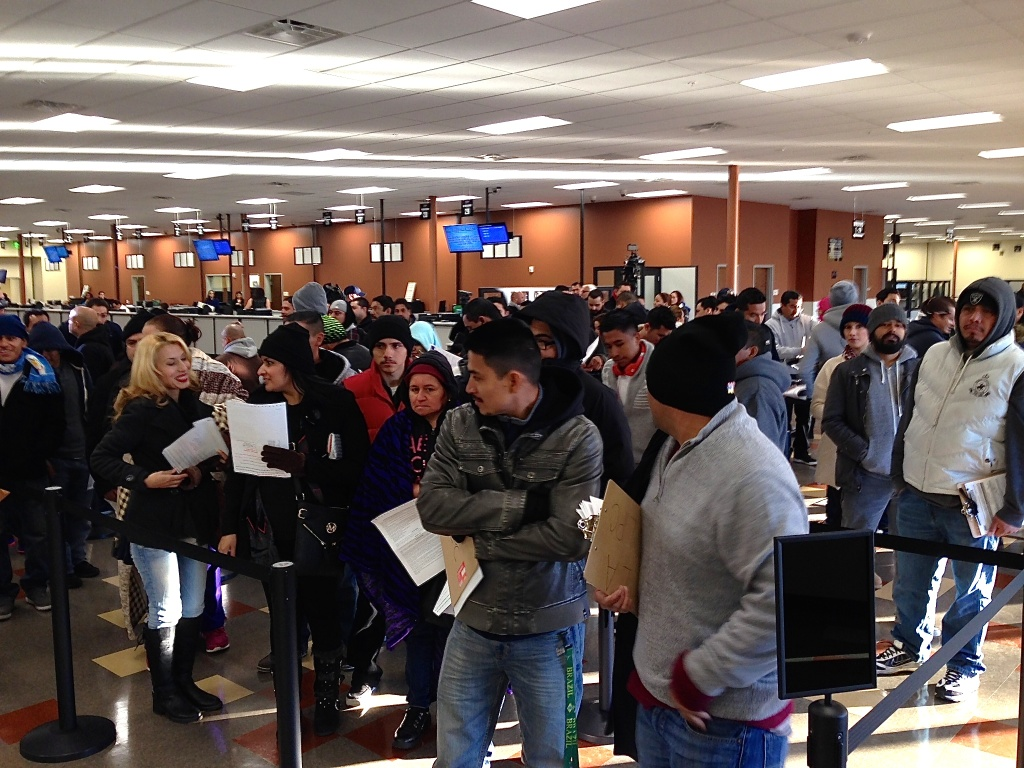 Hundreds of immigrants crowd into the Granada Hills DMV to apply for driver's licenses on Friday, Jan. 2, 2015.