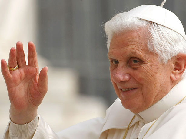 Pope Benedict XVI waves from the popemobile during his weekly general audience, in St. Peter's Square at the Vatican.
