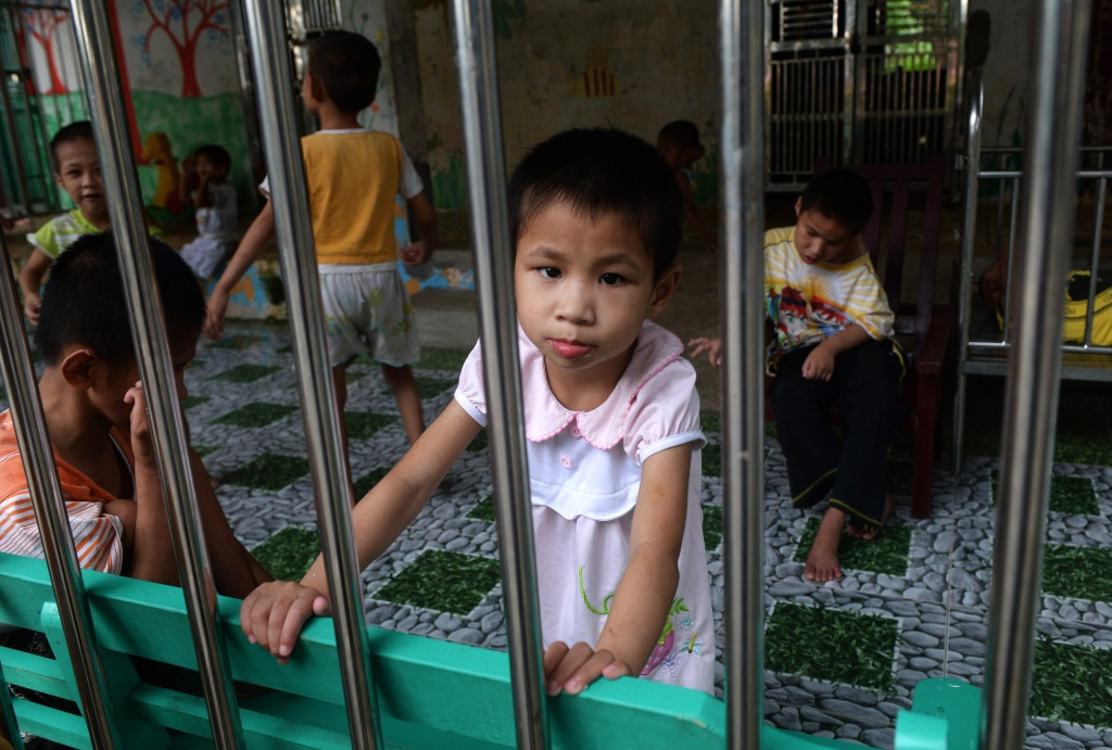 A young girl looks at visitors inside a state-run orphanage in Ba Vi district, in the outskirts of Hanoi on September 16, 2014.