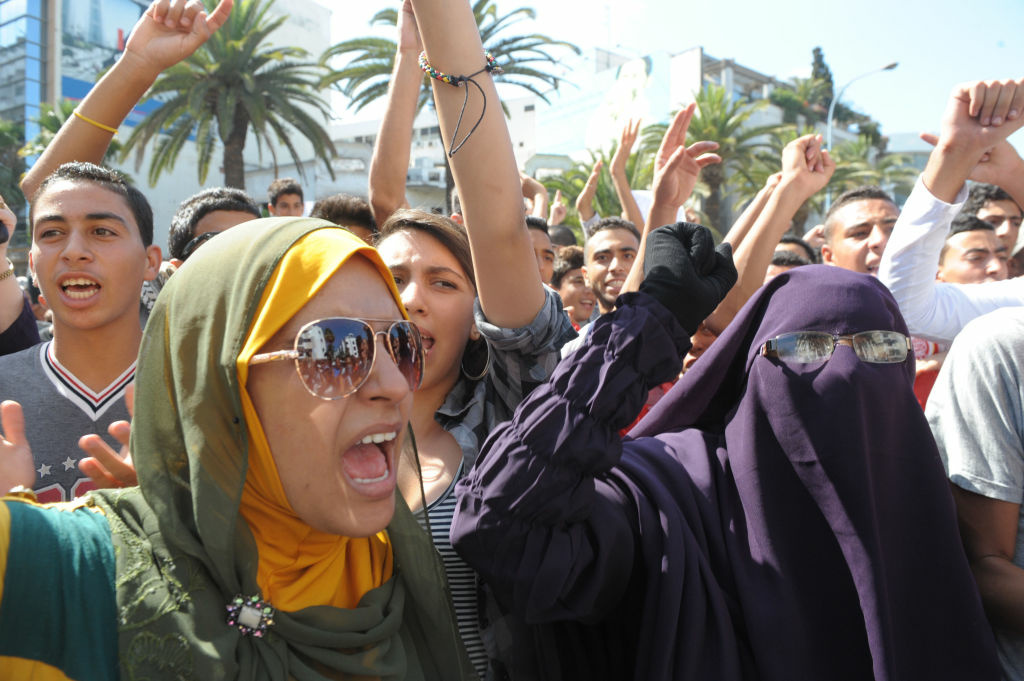 Moroccan women shout slogans during a demonstration against a film deemed offensive to Islam, on September 12, 2012 near the US consulate in Casablanca. A film at the center of anti-US protests in the Middle East which killed a diplomat was made by an Israeli-American who describes Islam as a 'cancer,' the Wall Street Journal reported. The movie, 'Innocence of Muslims,' was directed and produced by Sam Bacile, a 52-year-old real-estate developer from southern California who says Islam is a hateful religion.