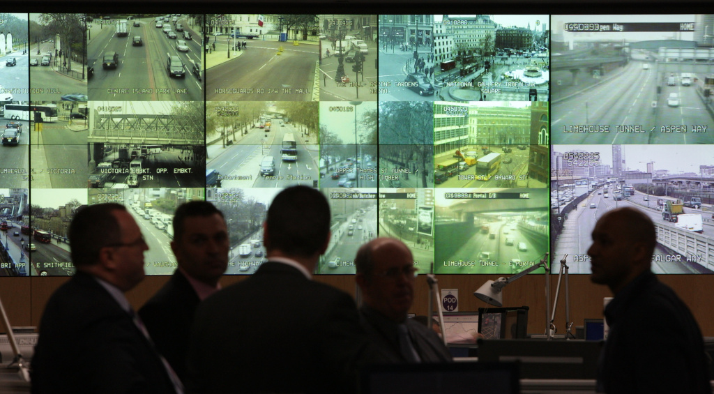 Metropolitan Police officers view displays from CCTV cameras around London in the Special Operations Room in London, England.