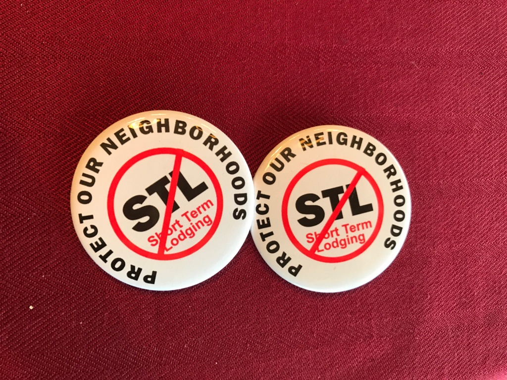Buttons handed out by opponents of short-term lodging, or vacation rentals, in Laguna Beach. The Coastal Commission voted on December 14 to approve the city's rules on vacation rentals only if it allows them in residential areas.