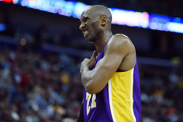Kobe Bryant #24 of the Los Angeles Lakers grabs his right shoulder during a game against the New Orleans Pelicans at the Smoothie King Center.