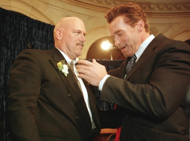 Former pro wrestling bad guy Jesse Ventura (L) is