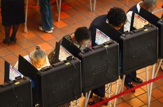 Voters in Miami-Dade County cast ballots in the 2010 midterm election. The changing politics of the large, multiracial Latino voting population there and throughout Florida could turn it into one of the swingiest states this presidential election.