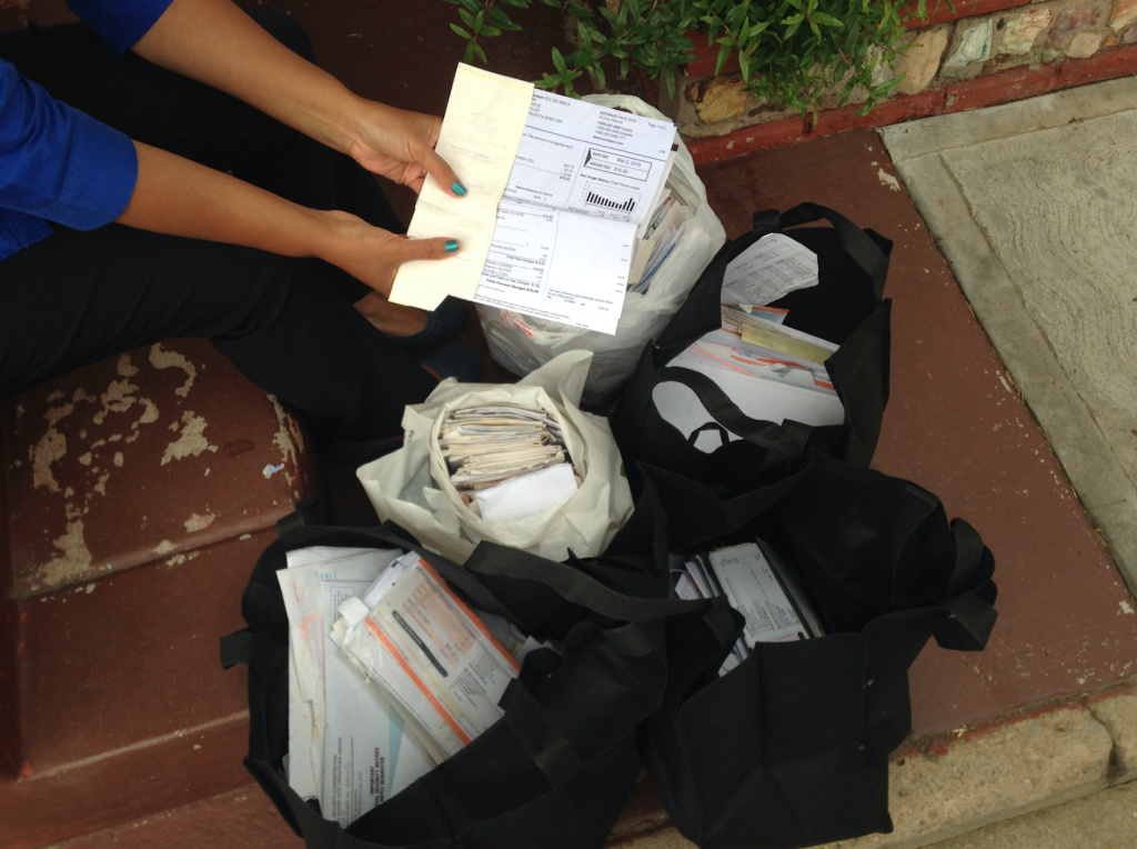 Isabel Medina of East Los Angeles and her husband have saved bags full of receipts, bills and other documents to prove their long-term residency in the United States. Both hope to obtain temporary legal status under Obama's executive immigration plan as the parents of U.S. citizen children.