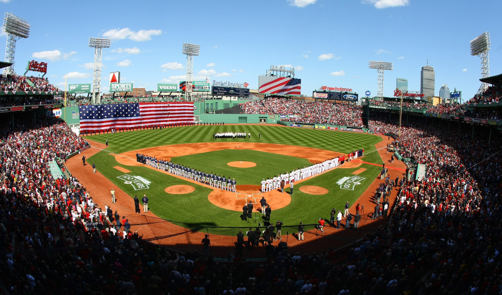 The Boston Red Sox and the Tampa Bay Rays line up for the national anthem during the home opener on April 13, 2012 at Fenway Park in Boston, Massachusetts.
