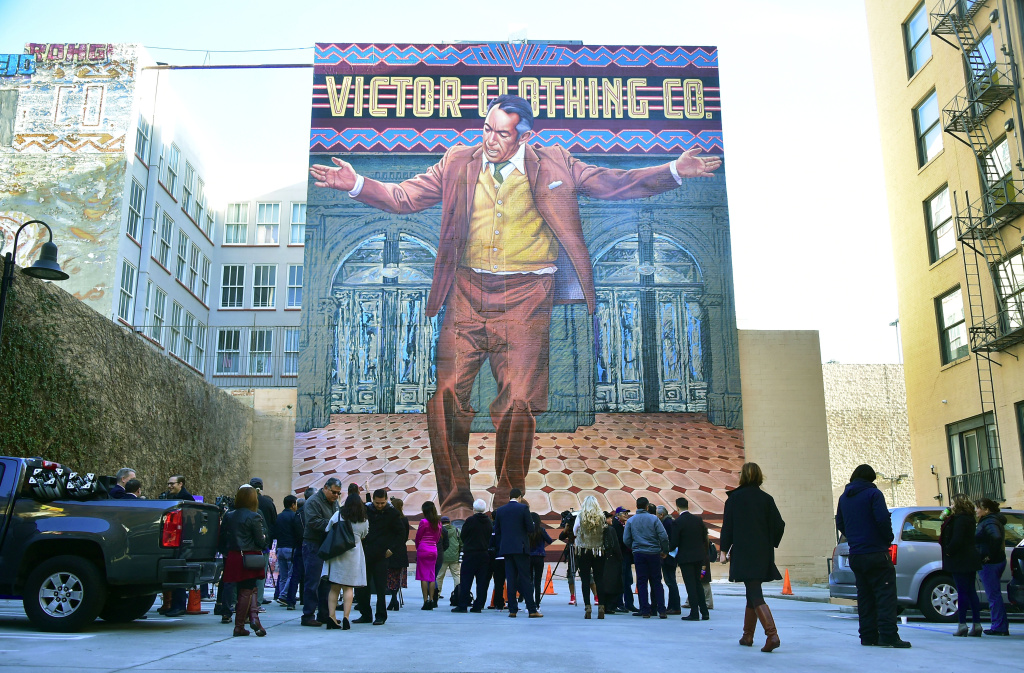 People gather to view the restoration by muralist Eloy Torres of Oscar-winning Actor Anthony Quinn's 70-foot-tall