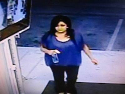 An image from a surveillance camera of a woman lottery officials believed to be holding a ticket worth $23 million.