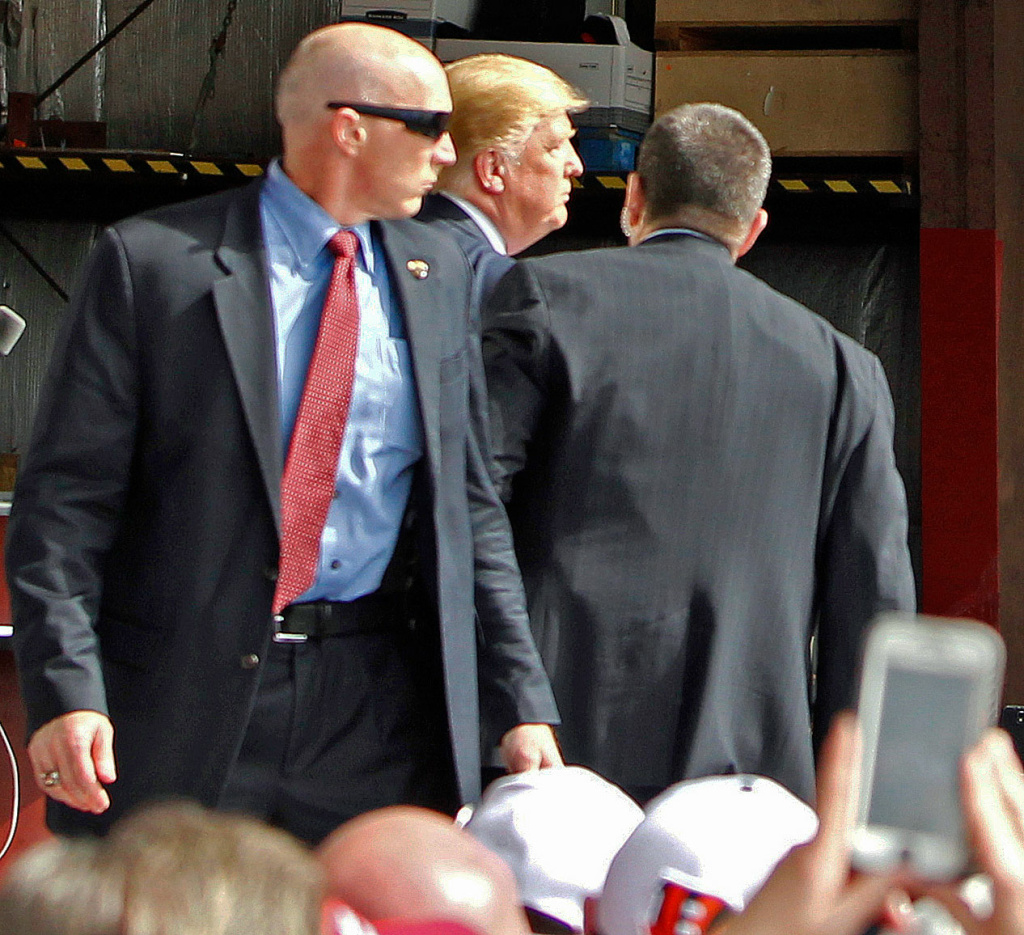 U.S. Secret Service agents guard Republican presidential candidate, businessman Donald Trump, on the stage after a man tried to breach the security buffer at his campaign event at the Wright Brothers Aero Hangar on March 12, 2016, in Vandalia, Ohio.