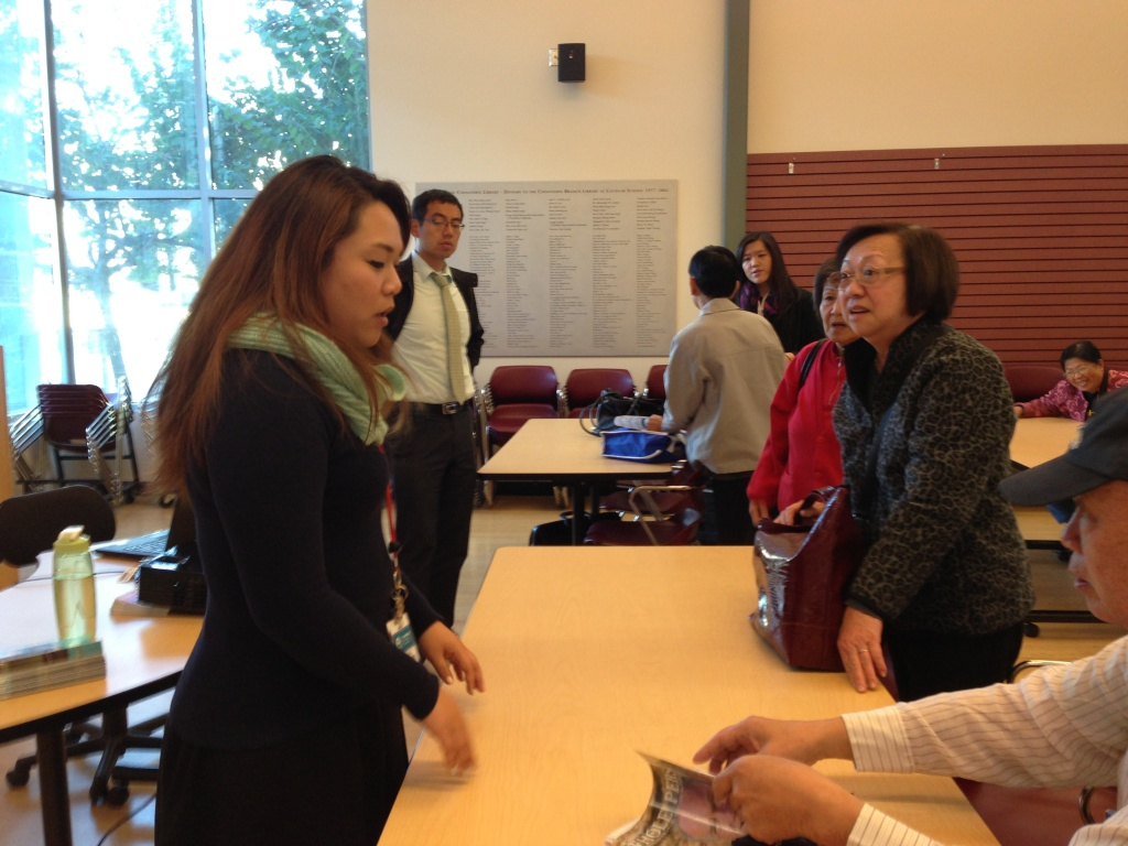 Teresa Ying, one of Covered California's certified enrollment counselors, explains provisions of the new health law to a group at the Los Angeles Public Library's Chinatown branch.