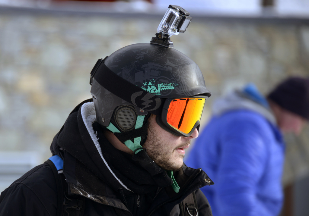 A skier carrying a GoPro camera on his helmet is seen on November 24, 2013 at Val Thorens, in the French Alps, during the ski station's opening week-end. Val Thorens is Europe's highest ski station (2300 m) and has opened three slopes two days in advance due to recent snow falls.