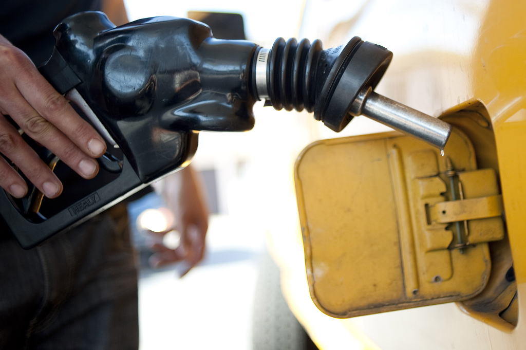 A man pumps gas into his pickup truck at a gas station in Los Angeles on Aug. 10, 2012.