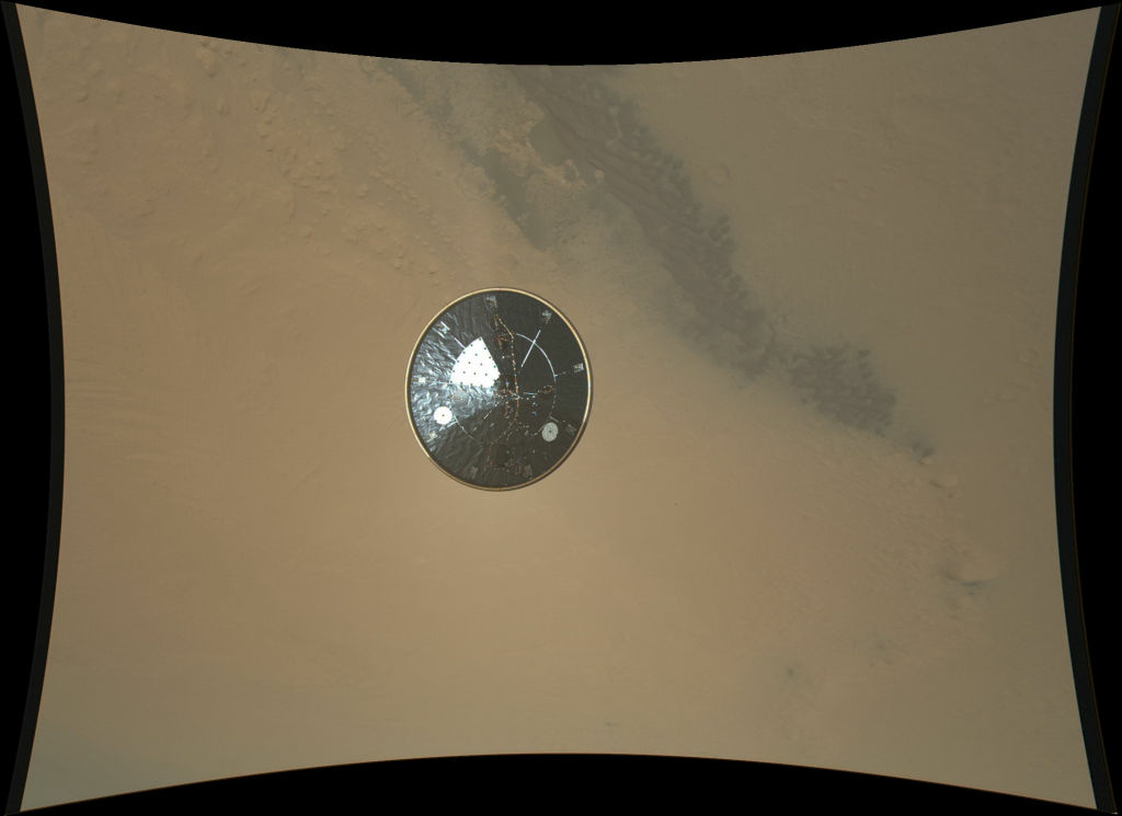 This color full-resolution image showing the heat shield of NASA's Curiosity rover was obtained during descent to the surface of Mars on Aug. 5 PDT (Aug. 6 EDT). The image was obtained by the Mars Descent Imager instrument known as MARDI and shows the 15-foot (4.5-meter) diameter heat shield when it was about 50 feet (16 meters) from the spacecraft.